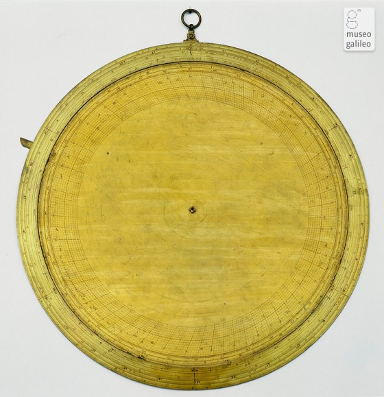 """Designed by Robert Dudley and made by Charles Whitwell, this large disk bears only a superficial resemblance to the astrolabe. In fact, it probably belonged to a more complex instrument described in Dudley's Arcano del mare. A ruler complete with circle also forms part of this navigation instrument."" Source: Museo Galileo."